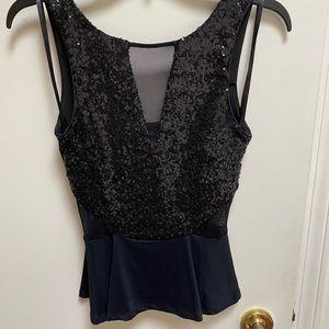 Bebe sequin mesh peplum top in black